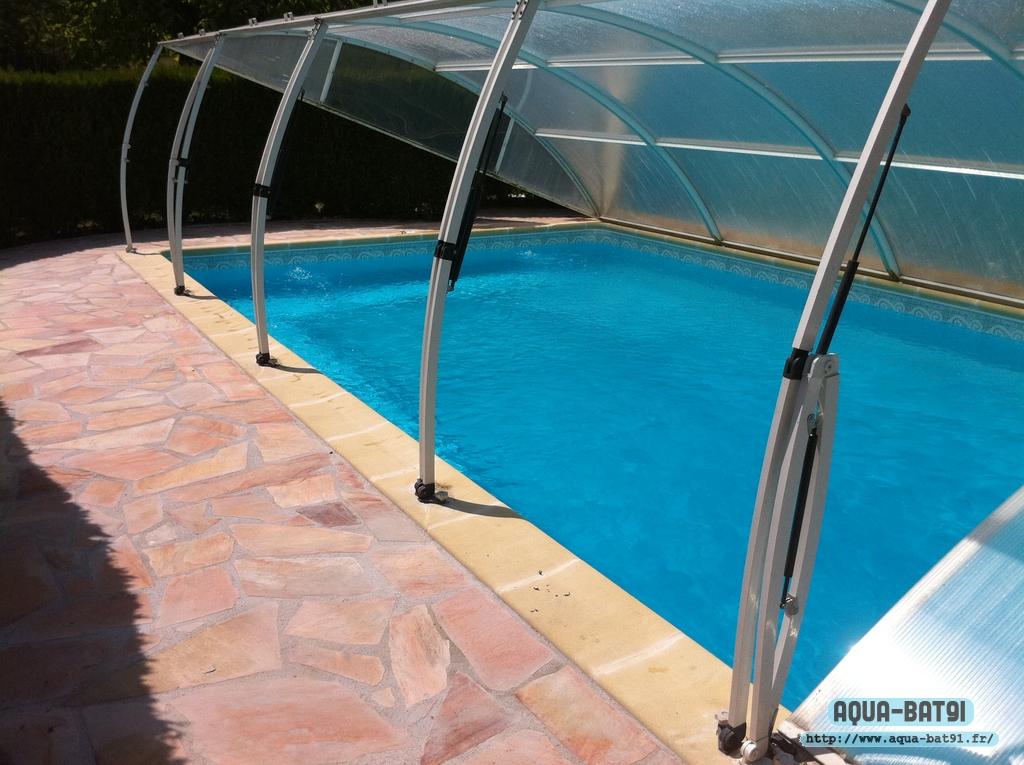 Pose abri de piscine aqua bat91 for Pose de piscine